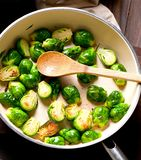 Homemade Grilled Brussel Sprouts with Fresh Bacon. stock photo