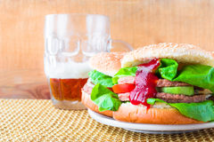 Homemade grilled hamburger cold beer Royalty Free Stock Photos