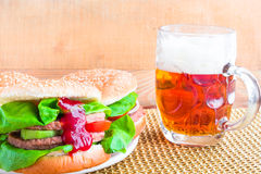 Homemade grilled hamburger cold beer Stock Photo