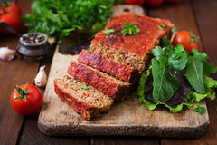 Homemade ground meatloaf with vegetables. Stock Photo