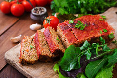Homemade ground meatloaf with vegetables. Royalty Free Stock Photography
