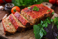 Homemade ground meatloaf with vegetables. Royalty Free Stock Image