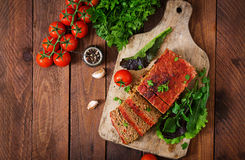 Homemade ground meatloaf with vegetables. Stock Images