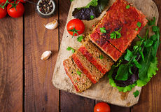 Homemade ground meatloaf with vegetables. Stock Photos