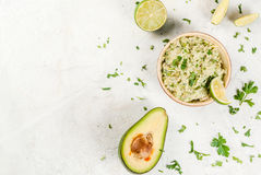 Homemade guacamole in bowl Stock Images