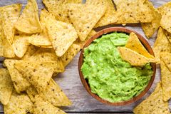 Homemade guacamole with corn chips top view Royalty Free Stock Image