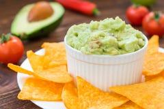 Homemade guacamole with crunchy nachos Stock Image