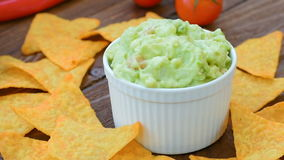 Homemade guacamole with crunchy nachos stock footage