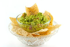 Homemade Guacamole Dip With Tortilla Chips. Homemade guacamole dip served with tortilla chips Stock Image
