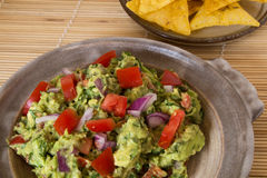 Homemade guacamole in a pottery dish Royalty Free Stock Photo