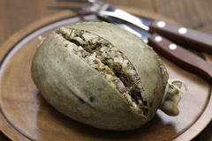 Homemade haggis, scotland food. Isolated on wooden background Royalty Free Stock Photo