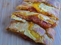 Homemade ham and cheese stromboli. Homemade low carb ham and cheese stromboli Stock Photos