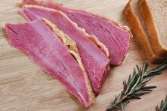 Homemade ham meat sliced on wooden desk. Royalty Free Stock Photos