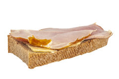 Homemade ham sandwich. Isolated homemade sandwich with butter and ham Royalty Free Stock Image