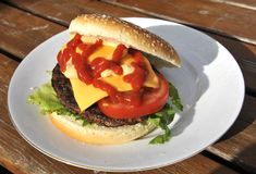 Homemade hamburger. Filled with vegetables, cheese and ketchup Royalty Free Stock Photo
