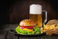 Homemade hamburger with beer and potatoes Stock Photography