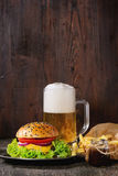 Homemade hamburger with beer and potatoes Royalty Free Stock Images