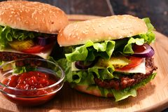 Homemade hamburger with cheese and fresh vegetables Stock Photography