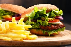 Homemade hamburger with cheese and fresh vegetables Stock Photo