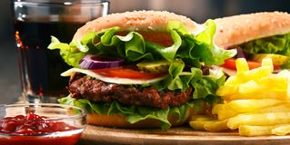 Homemade hamburger with cheese and fresh vegetables Royalty Free Stock Photo