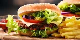 Homemade hamburger with cheese and fresh vegetables Royalty Free Stock Photos