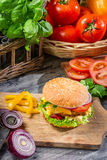 Homemade hamburger with chicken, tomato and onion stock image
