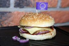 Homemade hamburger with EU flag. Hamburger with beef, cheese, onion, tomato and sauce. Homemade burger. EU flag Royalty Free Stock Photo