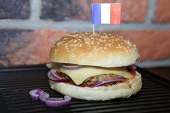 Homemade hamburger with french flag. Hamburger with beef, cheese, onion, tomato and sauce. Homemade burger. French flag Royalty Free Stock Images