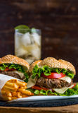 Homemade Hamburger with Fresh Vegetables and Drink with Ice Royalty Free Stock Images