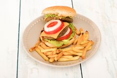 Hamburger and french fries. Homemade hamburger with fresh vegetables and french fries ,close-up Royalty Free Stock Photos
