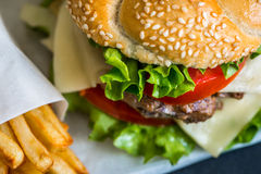 Homemade Hamburger with Fresh Vegetables and French Fries Royalty Free Stock Photos