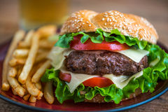 Homemade Hamburger with Fresh Vegetables and French Fries Stock Images