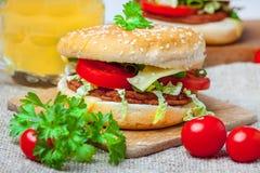 Homemade hamburger with fresh vegetables. Stock Photos