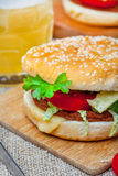 Homemade hamburger with fresh vegetables. Royalty Free Stock Image