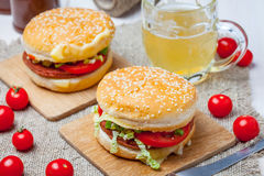 Homemade hamburger with fresh vegetables. Royalty Free Stock Photos