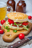 Homemade hamburger with fresh vegetables. Stock Photography