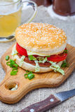 Homemade hamburger with fresh vegetables. Stock Photo