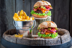 Homemade hamburger made of beef, cheese and vegetables Stock Images