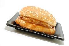 Homemade hamburger on a plate isolated Stock Photos