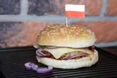 Homemade hamburger with polish flag. Hamburger with beef, cheese, onion, tomato and sauce. Homemade burger. Polish flag Royalty Free Stock Images