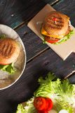 Homemade Hamburger on Wooden Background Royalty Free Stock Images