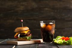 Homemade Hamburger on Wooden Background stock photos