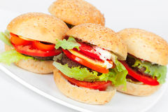 Homemade hamburgers lay on white plate Stock Photography