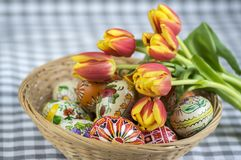 Homemade handmade painted Easter eggs on wicker basket, traditional handcraft eggs royalty free stock photos
