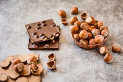 Homemade hazelnut chocolate bar. Nuts and chocolate background. Ingredients for cooking homemade chocolate sweets. Confectionery royalty free stock image