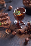 Homemade hazelnut spread or hot chocolate in glass bowl with nut Royalty Free Stock Photos