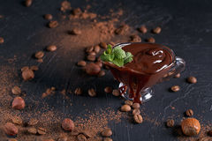 Homemade hazelnut spread or hot chocolate in glass bowl with nut Stock Photos
