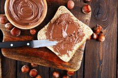 Homemade hazelnut spread with toast and in wooden bowl for break. Fast. Hazelnut Nougat cream Royalty Free Stock Images