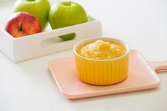 Homemade healthy baby food. Bowl of apple baby puree.  royalty free stock photography