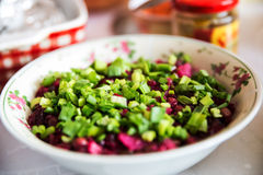 Beetroot salad with spring onions on top Stock Image
